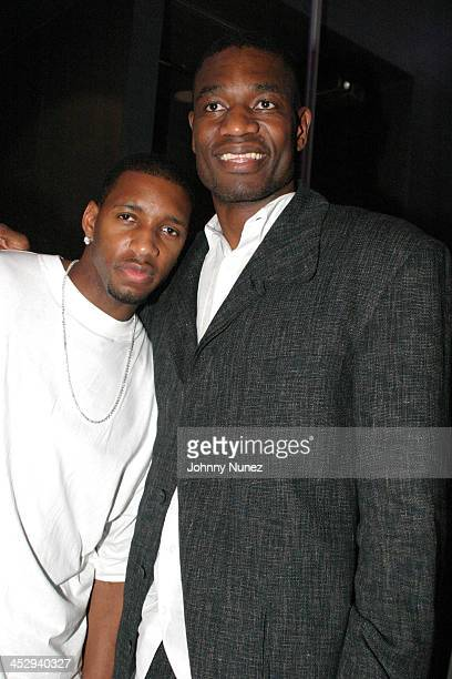 Tracy McGrady and Dikembe Motumbo during The Launch of Jay Z's 40/40 Club - Inside Party at 40/40 Sports Bar in New York City, New York, United...