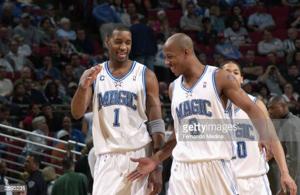Tracy McGrady and Keith Bogans of the Orlando Magic give each other a five during the game against the Philadelphia 76ers at the TD Waterhouse Centre...