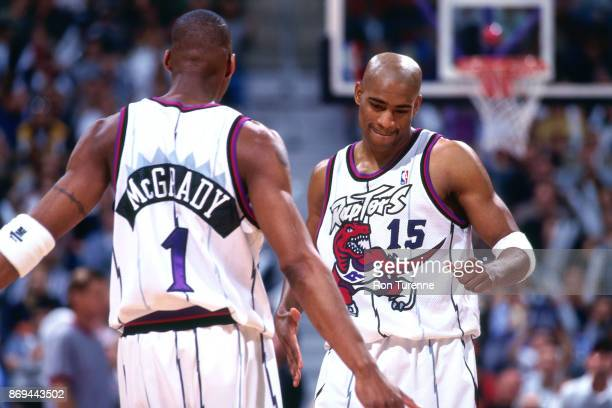 Tracy McGrady and Vince Carter of the Toronto Raptors look on circa 1999 at the Air Canada Centre in Toronto, Ontario. NOTE TO USER: User expressly...