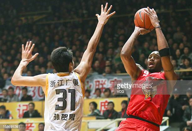 Tracy McGrady of Qingdao Eagles shoots the ball during the 13th round of the CBA 12/13 game against Zhejiang Lions at Hangzhou Gymnasium on December...