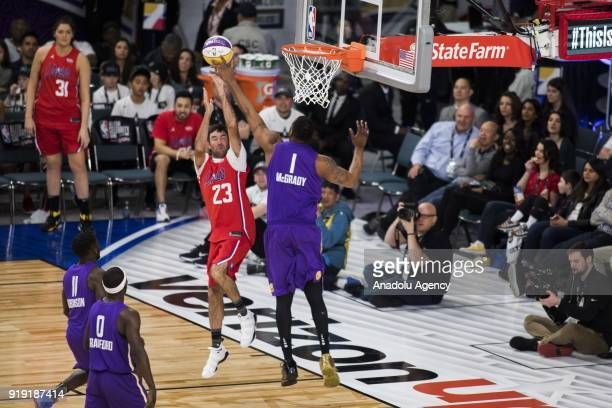 Tracy McGrady of Team Lakers blocks Bubba Watson of Team Clippers during the 2018 NBA AllStar Celebrity Game as part of AllStar Weekend at the Los...