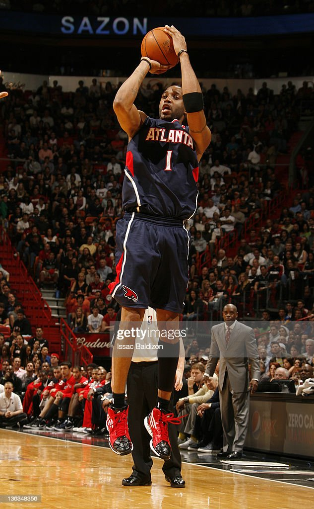 Tracy McGrady #1 of the Atlanta Hawks takes a jump shot during the fourth quarter against the Miami Heat on January 2, 2012 at American Airlines Arena in Miami, Florida.