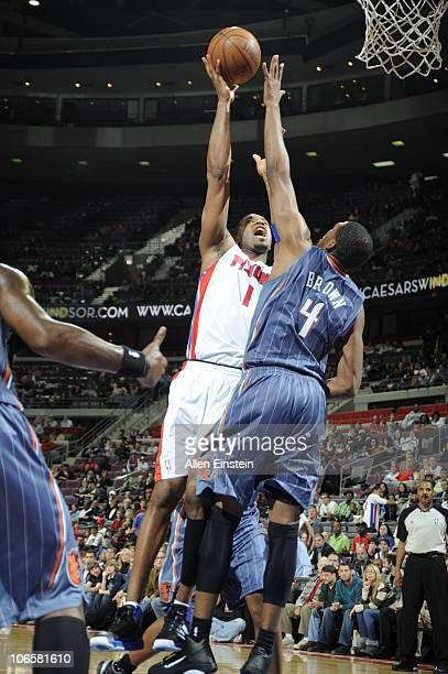 Tracy McGrady of the Detroit Pistons goes up for a shot against Derrick Brown of the Charlotte Bobcats in a game on November 5 2010 at The Palace of...
