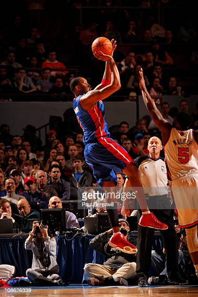 Tracy McGrady of the Detroit Pistons shoots against Bill Walker of the New York Knicks during a game on January 30 2011 at Madison Square Garden in...