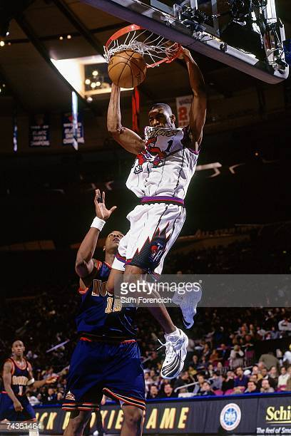 Tracy McGrady of the Eastern Conference finishes a dunk against the Western Conference during the 1998 Rookie Game played February 7 1998 at Madison...