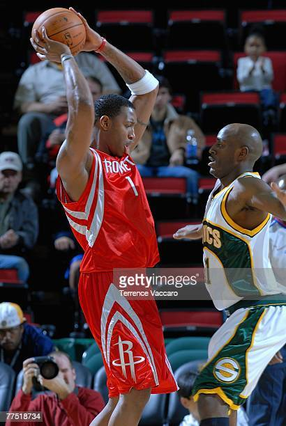 Tracy McGrady of the Houston Rockets comes under pressure from Damien Wilkins of the Seattle SuperSonics during the game at Key Arena on October 20...
