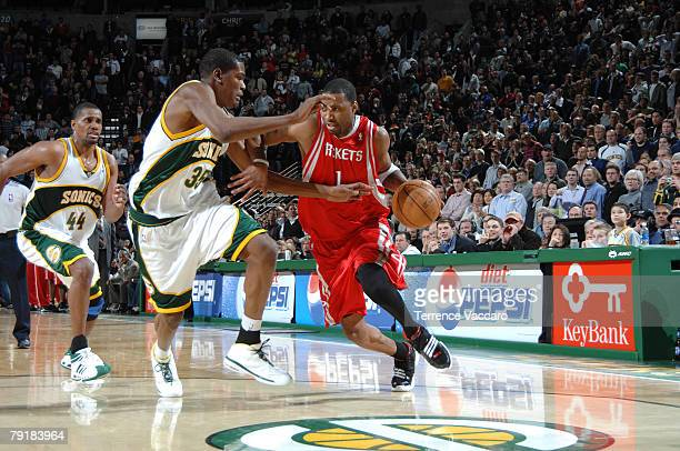 Tracy McGrady of the Houston Rockets drives against the defense of Kevin Durant of the Seattle SuperSonics on January 23 2008 at the Key Arena in...