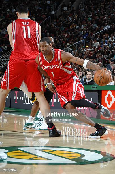 Tracy McGrady of the Houston Rockets drives pat the defense of Damien Wilkins of the Seattle SuperSonics on January 23 2008 at the Key Arena in...