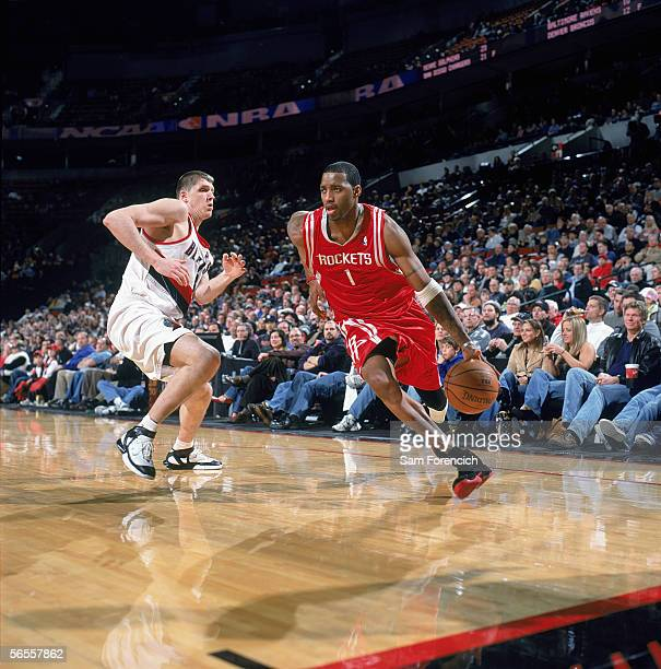 Tracy McGrady of the Houston Rockets drives the ballagainst the Portland Trail Blazers at The Rose Garden on December 11 2005 in Portland Oregon The...