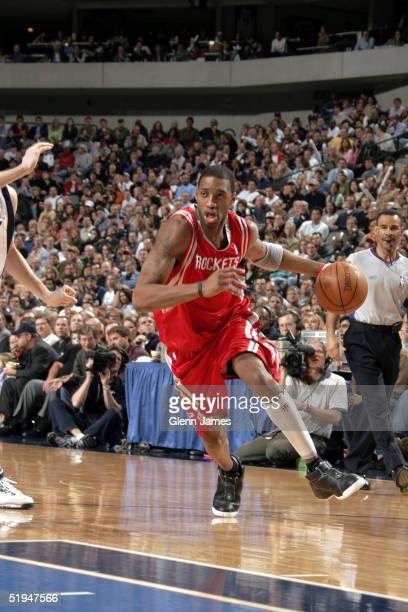 Tracy McGrady of the Houston Rockets drives to the basket against the Dallas Mavericks on January 12 2005 at the American Airlines Center in Dallas...