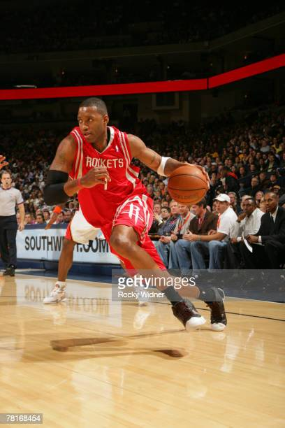 Tracy McGrady of the Houston Rockets drives to the basket against the Golden State Warriors on November 29 2007 at Oracle Arena in Oakland California...