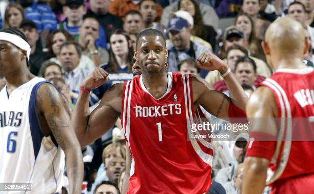 Tracy McGrady of the Houston Rockets flexes his muscles after making a shot and being fouled by the Dallas Mavericks in Game two of the Western...
