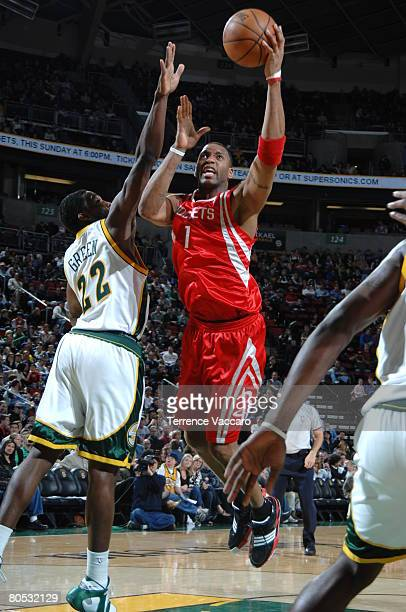 Tracy McGrady of the Houston Rockets goes to the basket against the defense of Jeff Green of the Seattle SuperSonics on April 4 2008 at the Key Arena...
