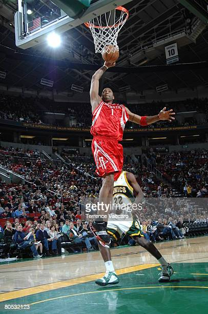 Tracy McGrady of the Houston Rockets goes to the basket past the defense of Jeff Green of the Seattle SuperSonics on April 4 2008 at the Key Arena in...