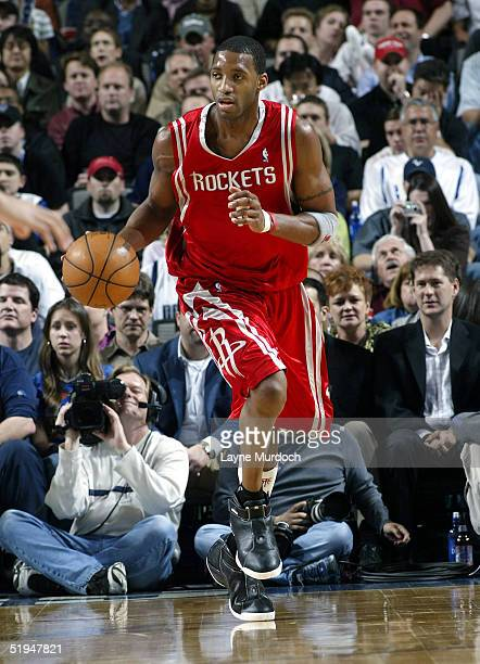 Tracy McGrady of the Houston Rockets handles the ball in NBA action against the Dallas Mavericks at the American Airlines Center January 12 2005in...
