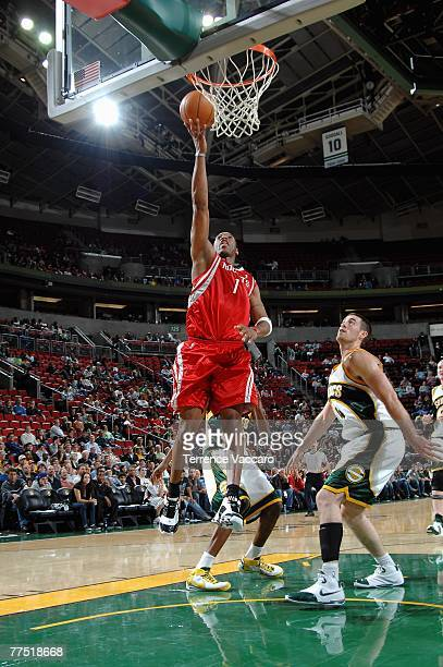 Tracy McGrady of the Houston Rockets lays the ball up over Nick Collison of the Seattle SuperSonics during the game at Key Arena on October 20 2007...