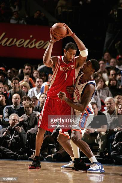 Tracy McGrady of the Houston Rockets looks to move the ball against Qyntel Woods of the New York Knicks during a game at Madison Square Garden on...