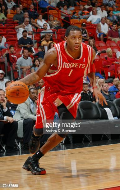 Tracy McGrady of the Houston Rockets moves the ball against the Miami Heat during the preseason game on October 25 2006 at the AmericanAirlines Arena...
