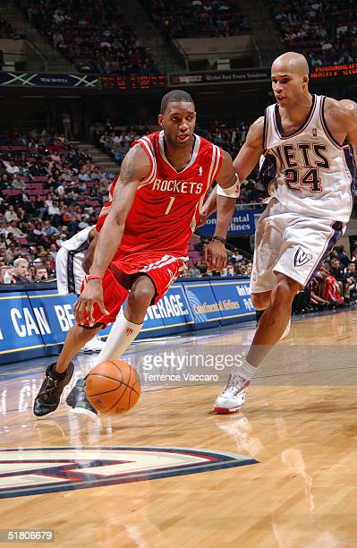 Tracy McGrady of the Houston Rockets moves the ball during the game against the New Jersey Nets on November 15 2004 at the Continental Airlines Arena...