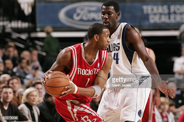 Tracy McGrady of the Houston Rockets moves the ball during the game with the Dallas Mavericks on January 12 2005 at the American Airlines Center in...