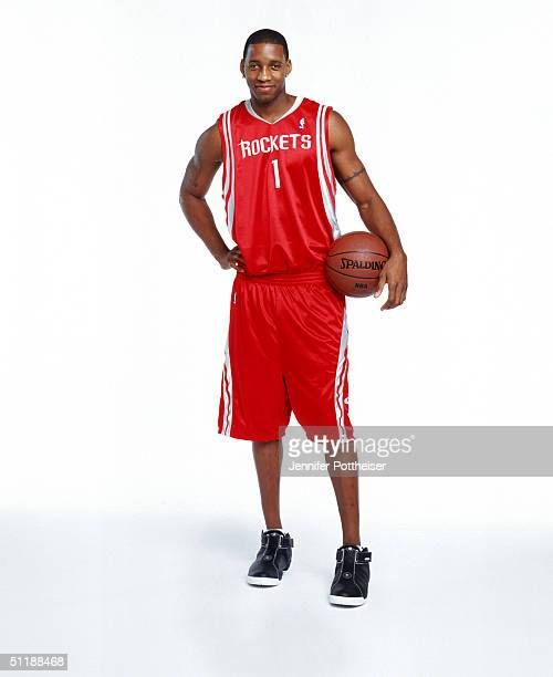 Tracy McGrady of the Houston Rockets poses for a portrait during a photo shoot at St Lukes Methodist Church on August 6 2004 in Orlando Florida NOTE...