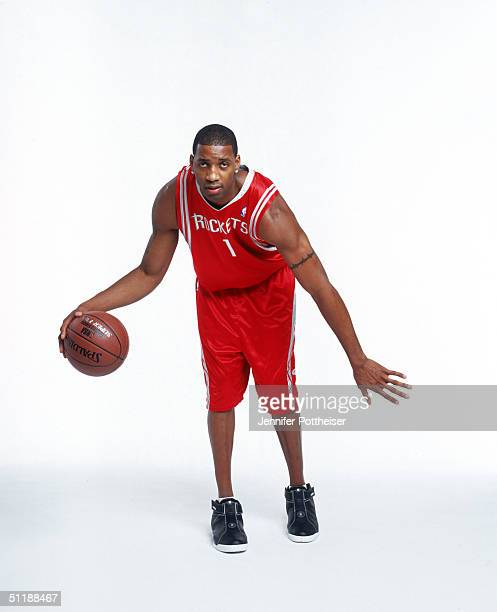 Tracy McGrady of the Houston Rockets poses for an action portrait during a photo shoot at St Lukes Methodist Church on August 6 2004 in Orlando...