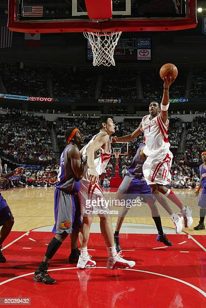 Tracy McGrady of the Houston Rockets shoots a layup against the Phoenix Suns on January 5 2005 at the Toyota Center in Houston Texas The Suns won...