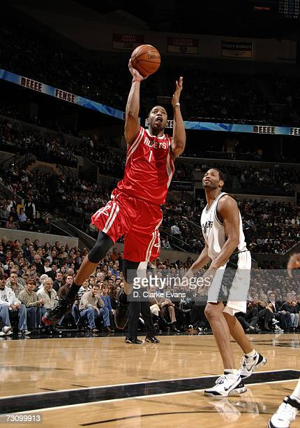 631ce5a2461 Tracy McGrady of the Houston Rockets shoots after driving past Robert Horry  of the San Antonio. Houston Rockets v San Antonio Spurs