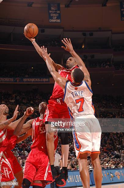 Tracy McGrady of the Houston Rockets shoots against Channing Frye of the New York Knicks on February 5 2006 at Madison Square Garden in New York City...