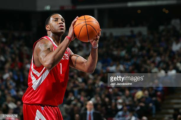 Tracy McGrady of the Houston Rockets shoots against the Sacramento Kings during an NBA game at Arco Arena January 13 2007 in Sacramento California...