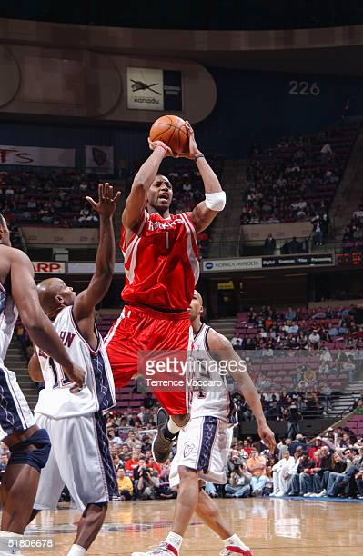 Tracy McGrady of the Houston Rockets shoots during the game against the New Jersey Nets on November 15 2004 at the Continental Airlines Arena in East...