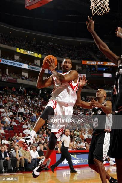 Tracy McGrady of the Houston Rockets shoots over Bruce Bowen and Francisco Elson of the San Antonio Spurs on November 14 2006 at the Toyota Center in...