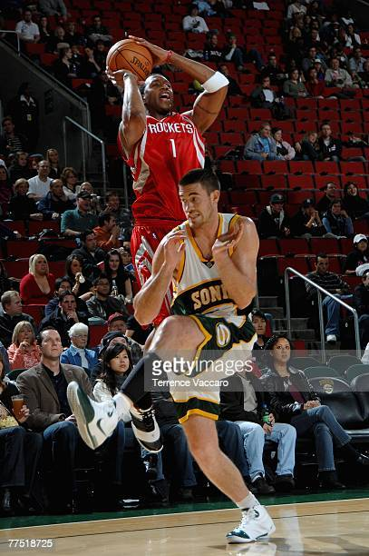 Tracy McGrady of the Houston Rockets shoots over Nick Collison of the Seattle SuperSonics during the game at Key Arena on October 20 2007 in Seattle...