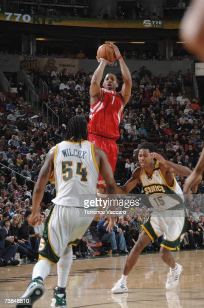 Tracy McGrady of the Houston Rockets shoots over the defense of Chris Wilcox and Mickael Gelabale of the Seattle SuperSonics on April 9 2007 at the...
