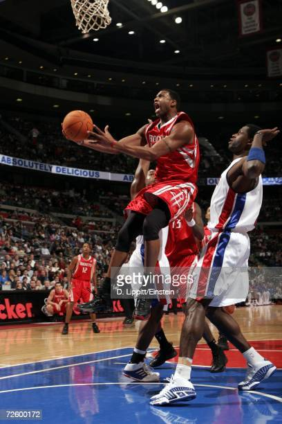 Tracy McGrady of the Houston Rockets shoots past Antonio McDyess of the Detroit Pistons during a game on November 18, 2006 at the Palace of Auburn...