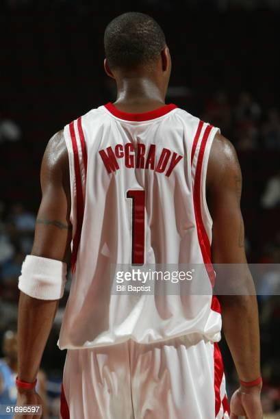 Tracy McGrady of the Houston Rockets stands on the court during the preseason game with the Denver Nuggets on October 28 2004 at Toyota Center in...