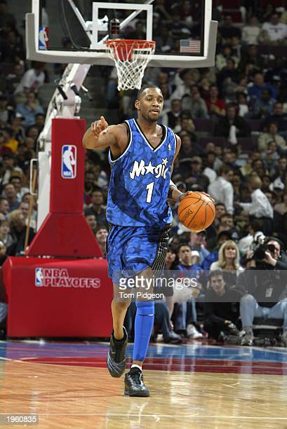 Tracy McGrady of the Orlando Magic advances the ball against the Detroit Pistons in Game two of the Eastern Conference Quarterfinals during the 2003...