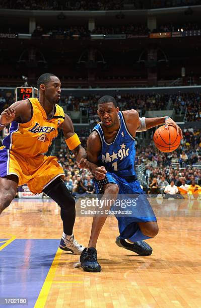 Tracy McGrady of the Orlando Magic cuts to the basket defended by Kobe Bryant of the Los Angeles Lakers during the NBA game against the Los Angeles...
