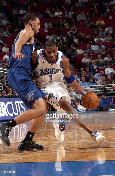 Tracy McGrady of the Orlando Magic dribbles past Jared Jeffries of the Washington Wizards during a game played at TD Waterhouse Centre on March 10,...
