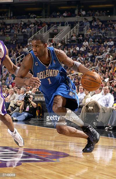 Tracy McGrady of the Orlando Magic drives against the Phoenix Suns November 20 2003 at America West Arena in Phoenix Arizona NOTE TO USER User...