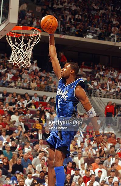 Tracy McGrady of the Orlando Magic dunks against the Detroit Pistons in Game one of the Eastern Conference Quarterfinals during the 2003 NBA Playoffs...