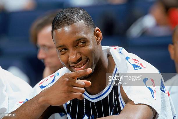 Tracy McGrady of the Orlando Magic enjoys a moment during the NBA game against the Golden State Warriors at The Arena in Oakland on March 17 2004 in...