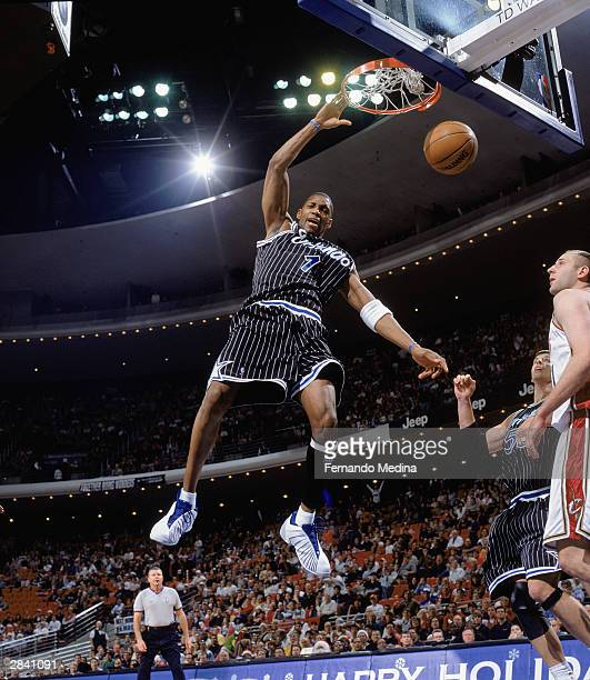 Tracy McGrady of the Orlando Magic follows through on his slam dunk against the Cleveland Cavaliers during the game on December 25, 2003 at TD...