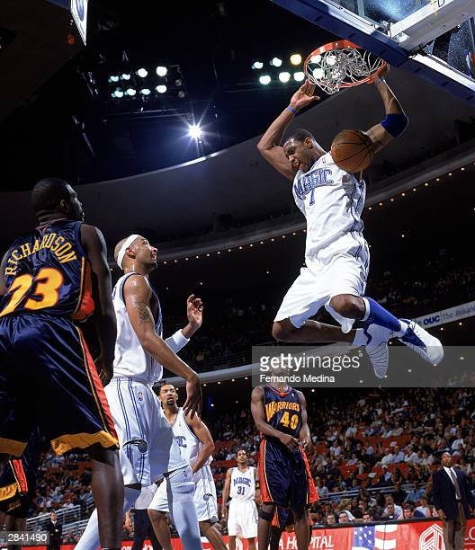 Tracy McGrady of the Orlando Magic goes for a layup during the NBA game against the Golden State Warriors at TD Waterhouse Centre on December 19 2003...