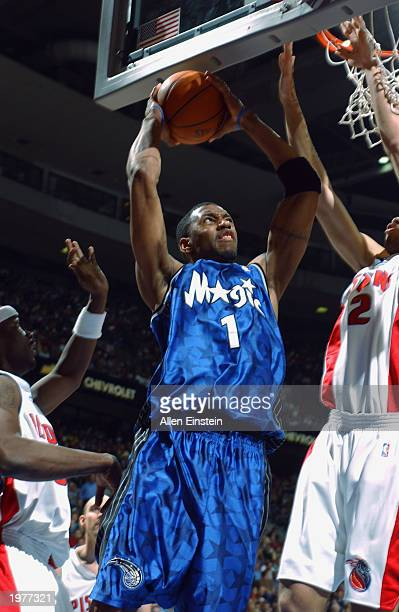 Tracy McGrady of the Orlando Magic goes up for a shot against the Detroit Pistons in Game five of the Eastern Conference Quarterfinals during the...