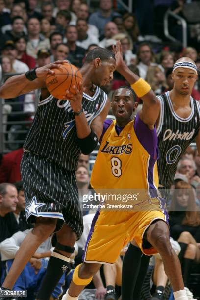 Tracy McGrady of the Orlando Magic on offense against Kobe Bryant of the Los Angeles Lakers during the first half of action on March 15 2004 at...