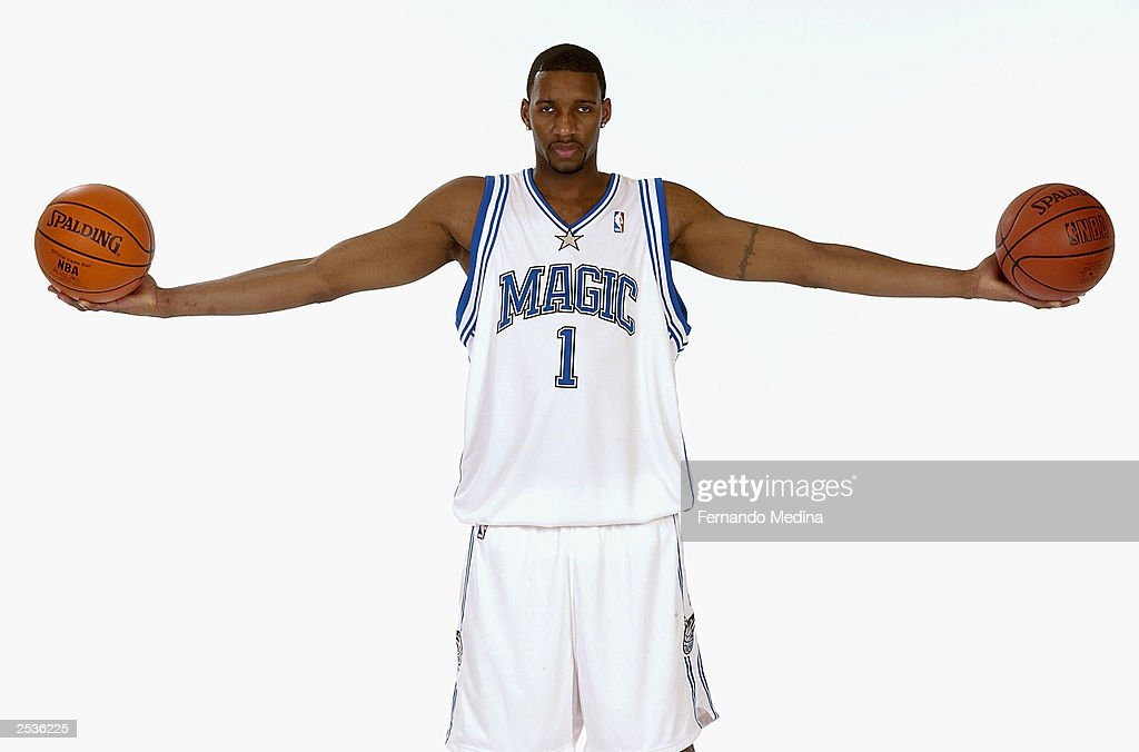 cf37c8f349ce Tracy McGrady of the Orlando Magic poses in the new Magic uniforms ...