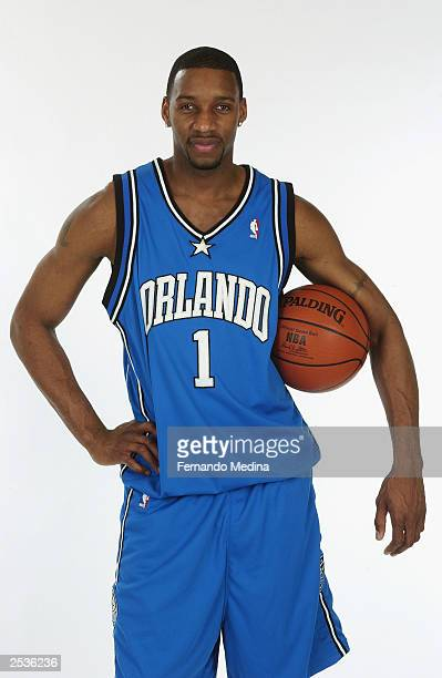 241273d2bff3 Tracy McGrady of the Orlando Magic poses in the new Magic uniforms on April  8 2003