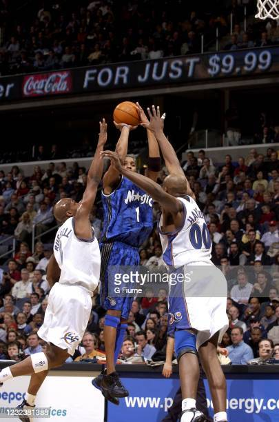 Tracy McGrady of the Orlando Magic shoots the ball against the Washington Wizards on March 11, 2003 at the MCI Center in Washington DC. NOTE TO USER:...