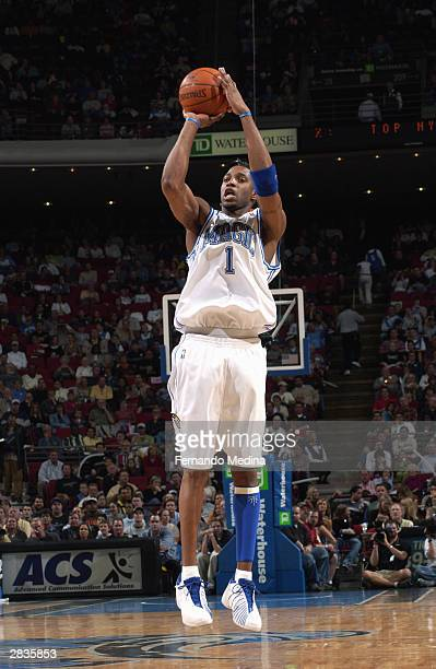 Tracy McGrady of the Orlando Magic takes an open jump shot during the game against the New Jersey Nets at TD Waterhouse Centre on December 12 2003 in...